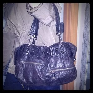 BeBe beautiful distressed soft leather handbag